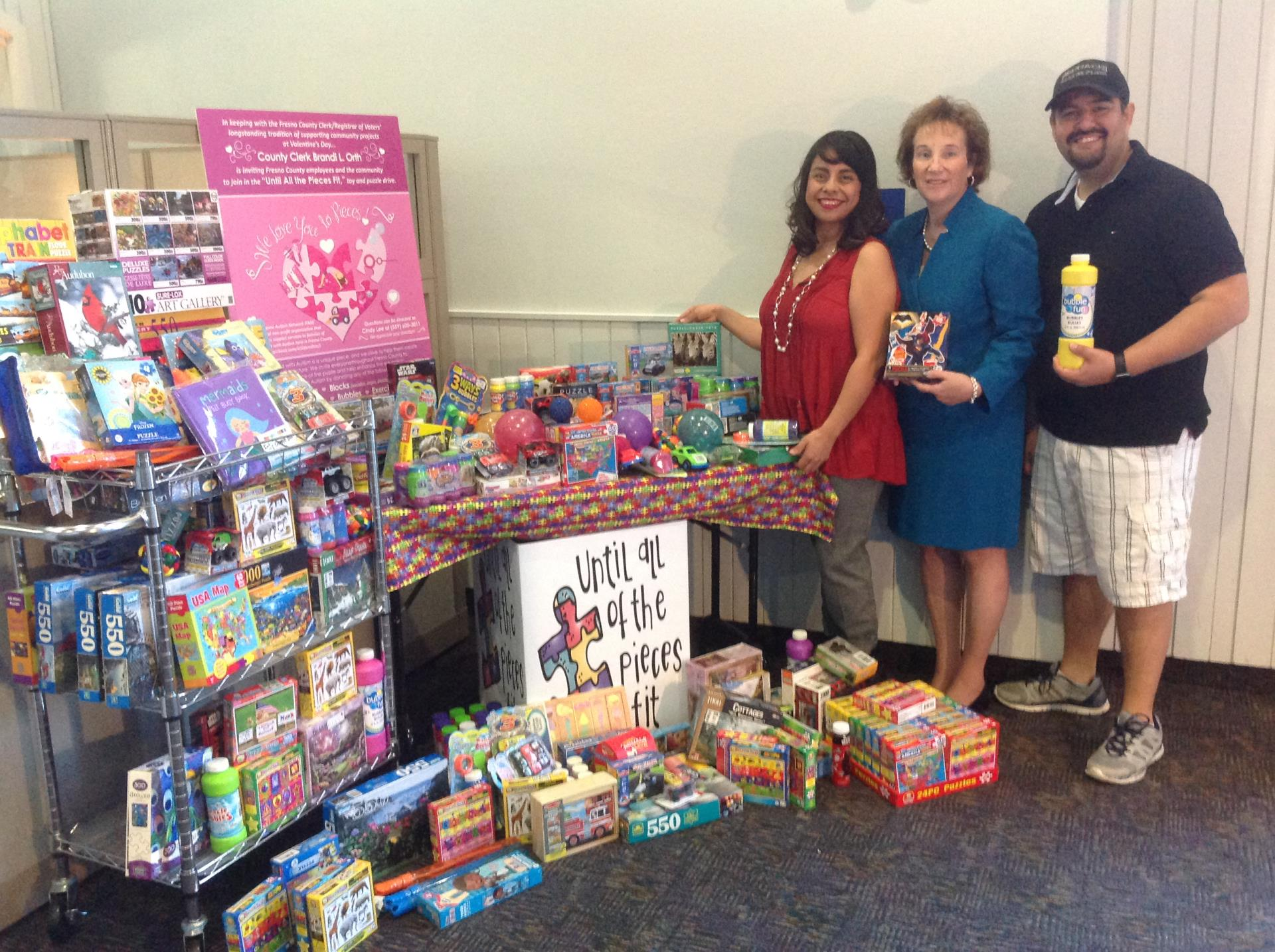 Autism Awareness volunteers with table of toys